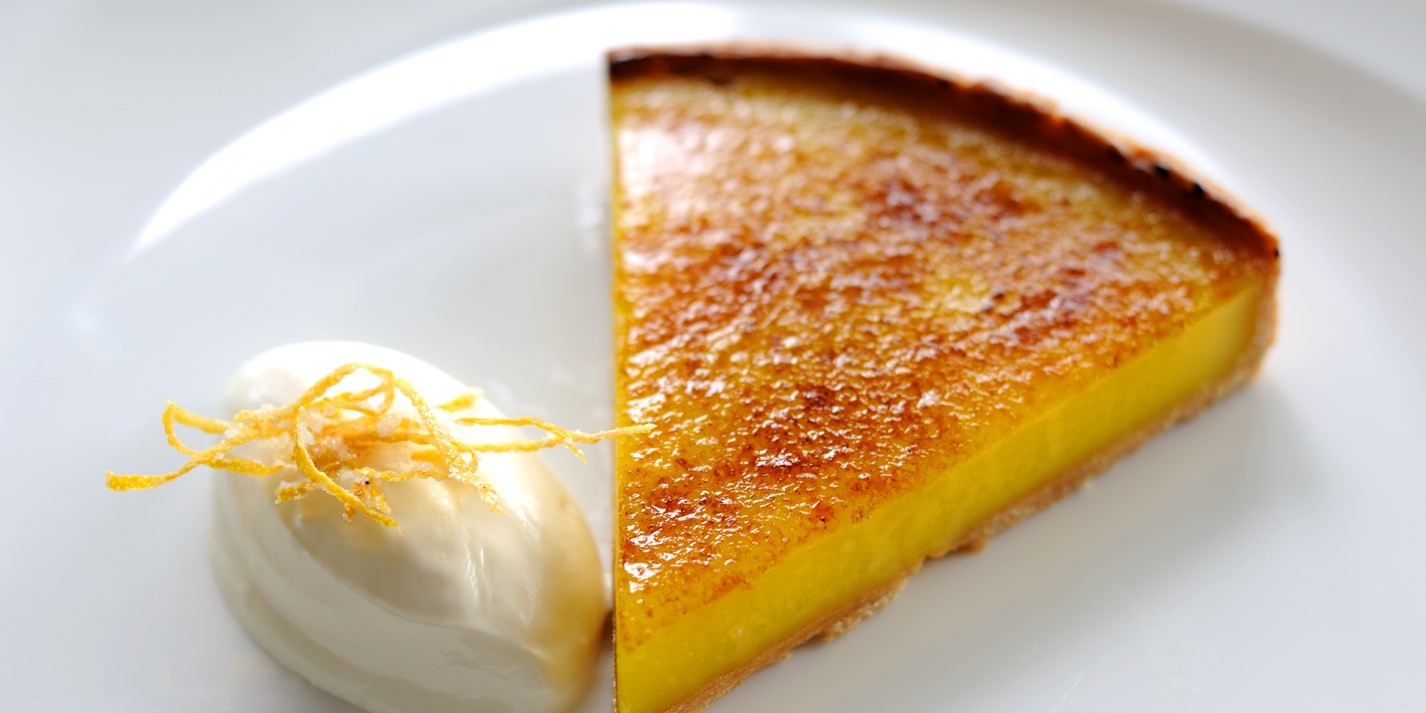 Glazed lemon tart with crème fraiche