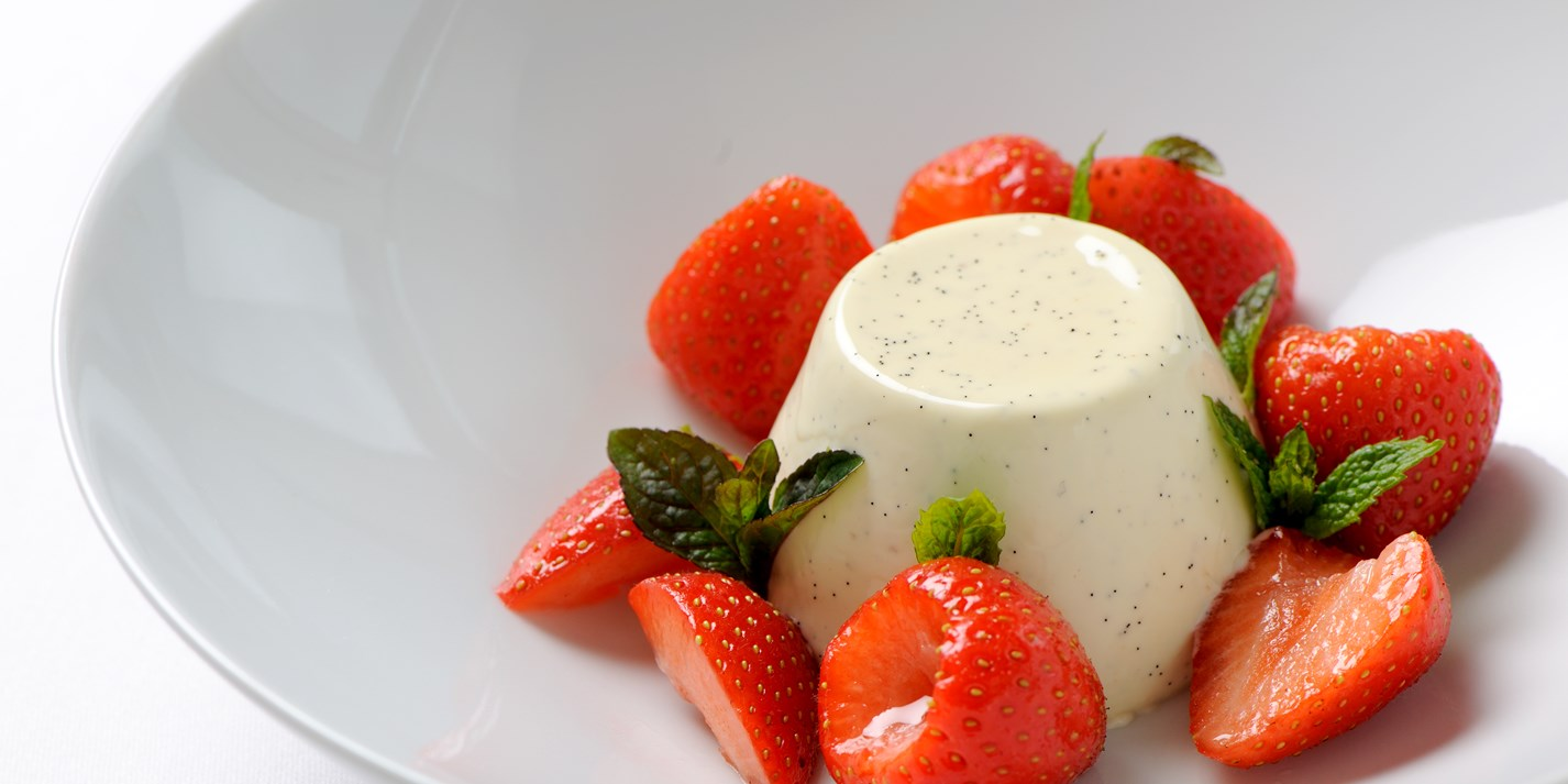 Vanilla panna cotta with strawberries and Grappa