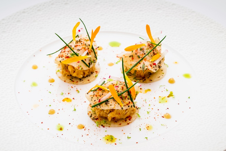 Crabmeat with thin ravioli of turnips, rosemary, sweet and sour dressing