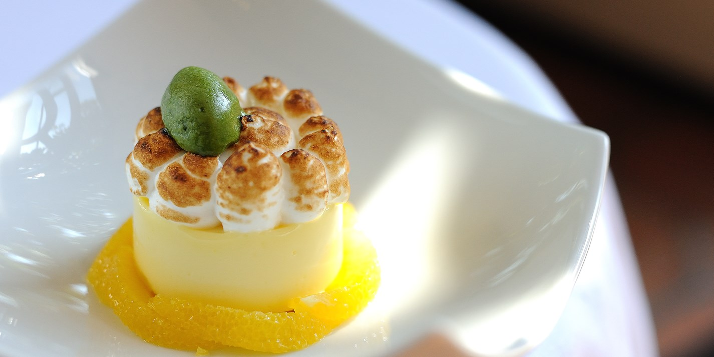 Lemon meringue pie with poached oranges and basil