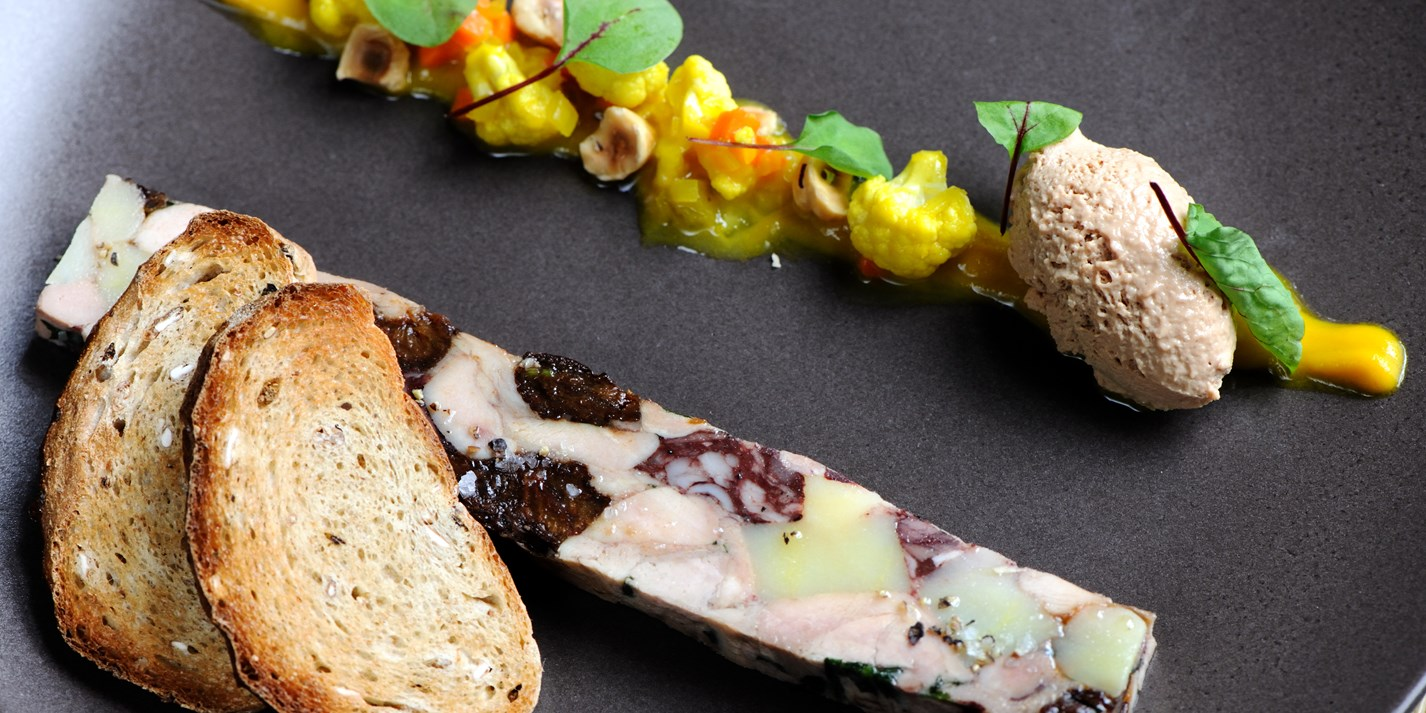 Chicken and black pudding terrine with piccalilli and toasted hazelnuts