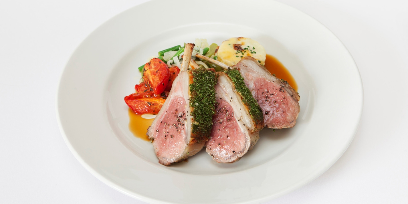 Herb and Dijon-crusted rack of lamb with Niçoise vegetables and gratin potatoes