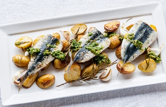 Grilled sardines with garlic roasted Jersey Royals and salsa verde