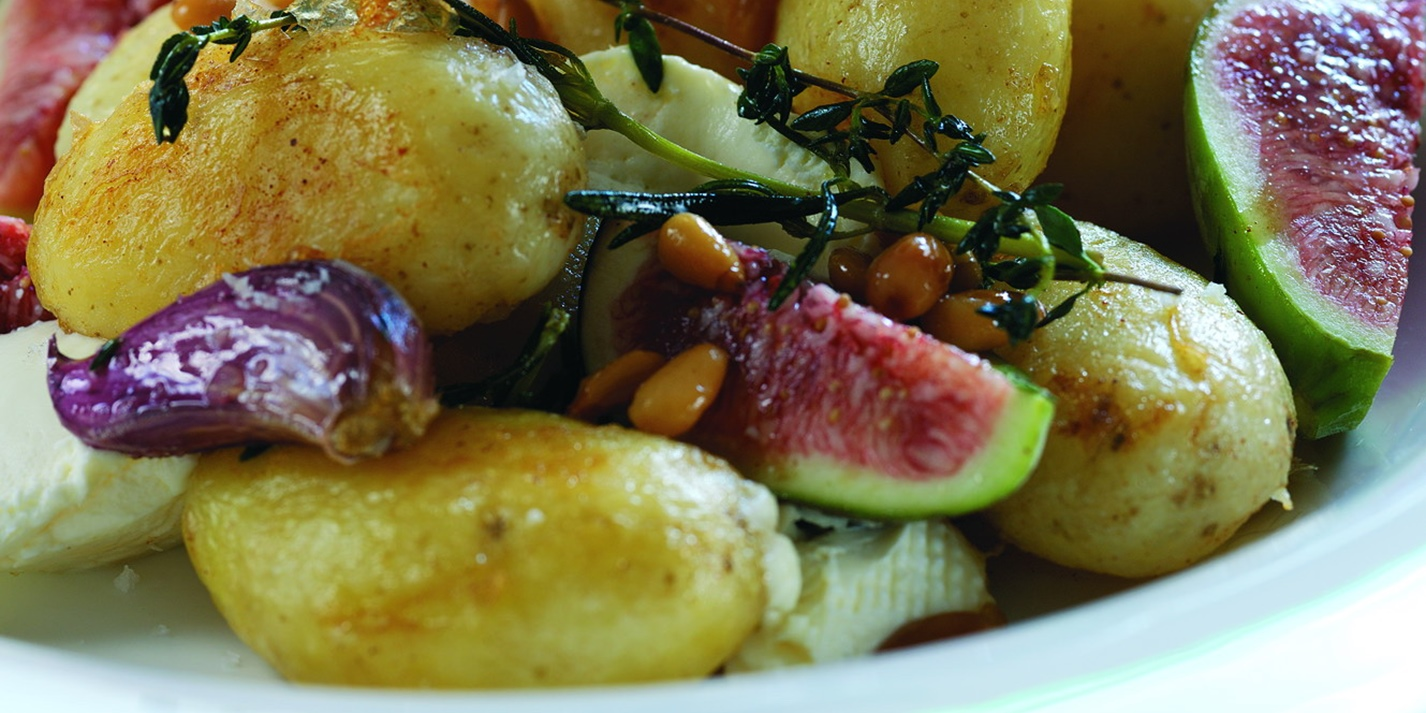 Warm salad of Jersey Royals with goat's cheese, pine nuts and fresh figs