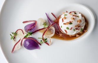 Poached duck egg with roasted onion consommé, lemon thyme and smoked duck