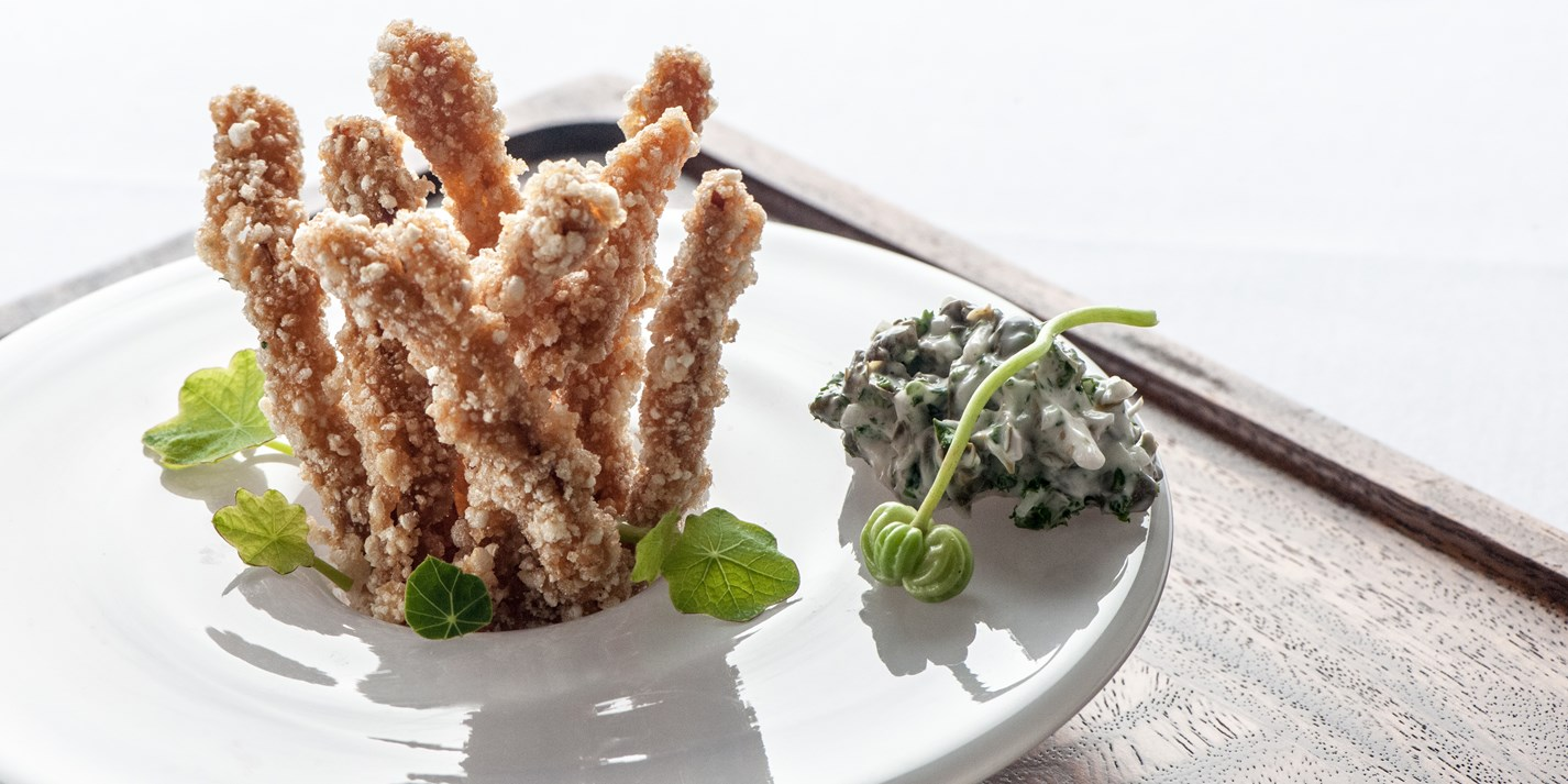Crispy pig's ears with nasturtium and caper tartare sauce