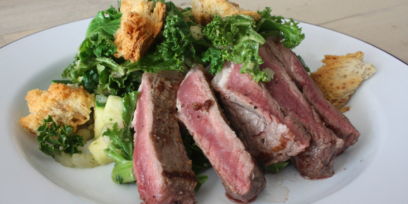 Warm Irish salad with sirloin steak and shamrock greens