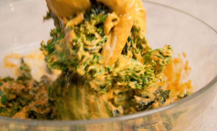 Pour the creamy mixture over the kale and squish until well covered
