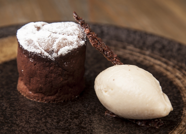 Hot chocolate fondant with brakspear black stout ice cream and cocoa nibs