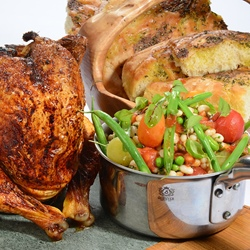 Organic barbecue beer can chicken, summer beans and garlic bread