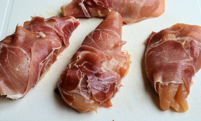Wrap Parma ham around each chicken breast