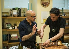 Stanley Tucci and Francesco Mazzei carving the roast veal