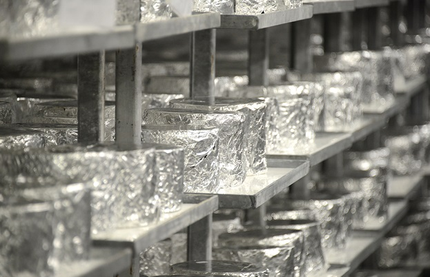 Foil-wrapped cheeses maturing