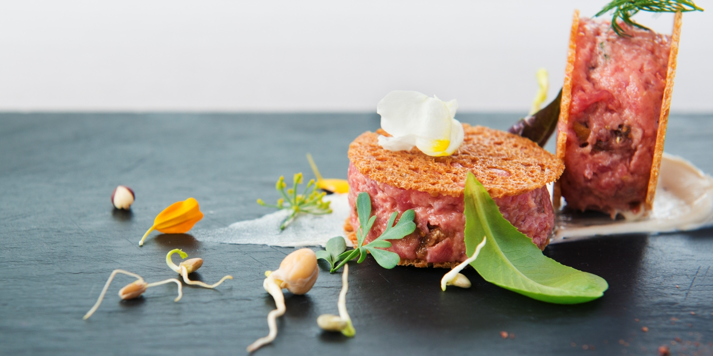 Veal tartare with figs, hazelnuts and anchovy butter