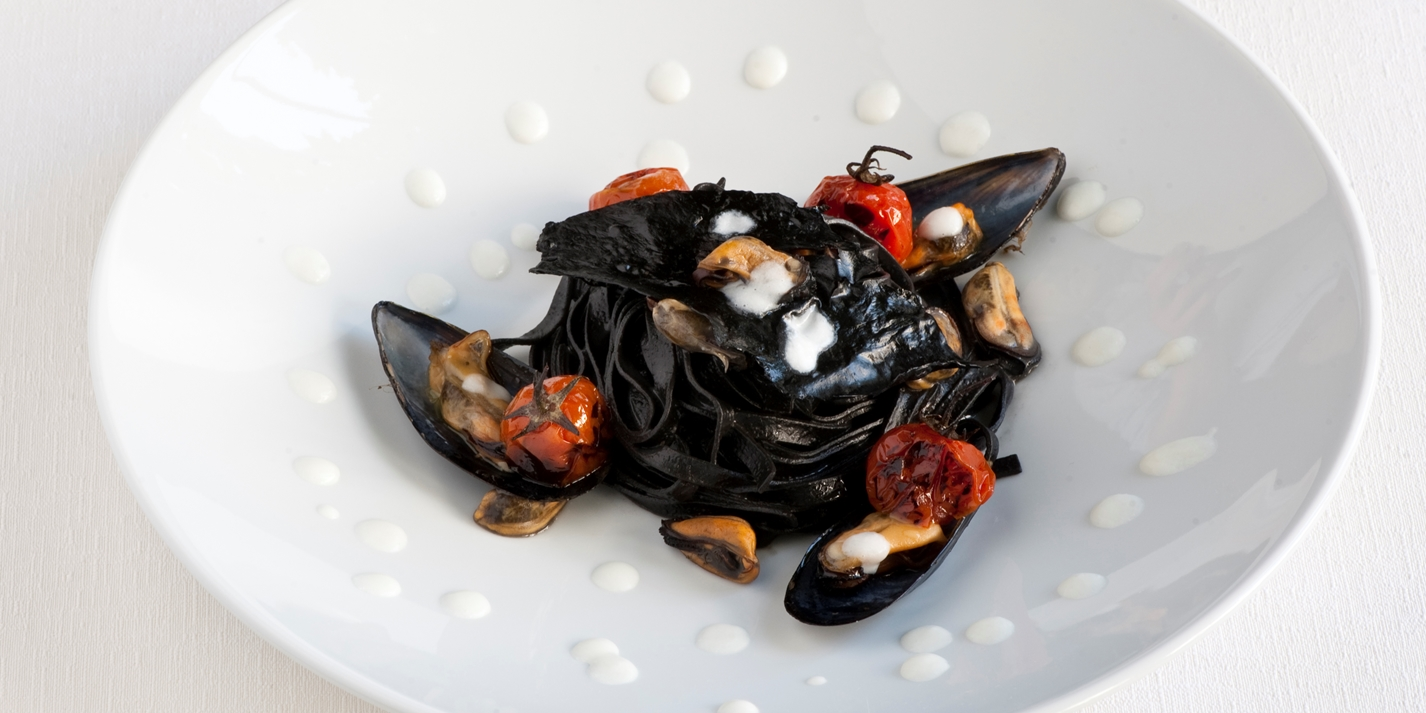 Soup with mussels and mozzarella milk