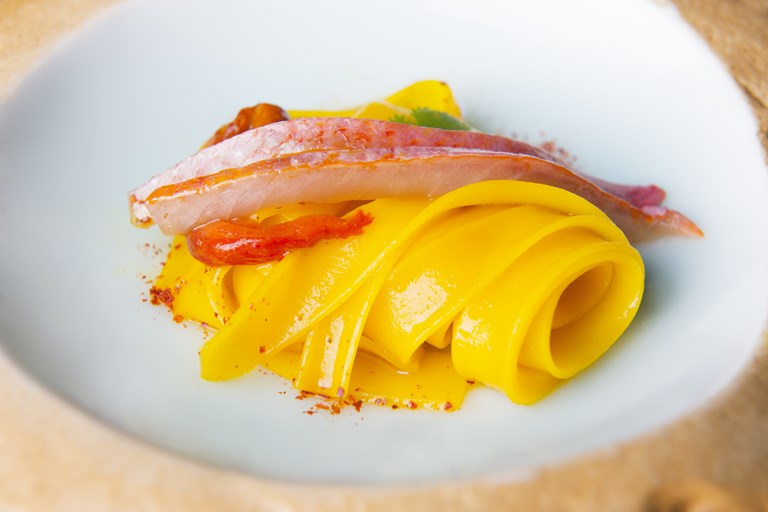 Rice tagliatelle, red mullet, peppers and bottarga
