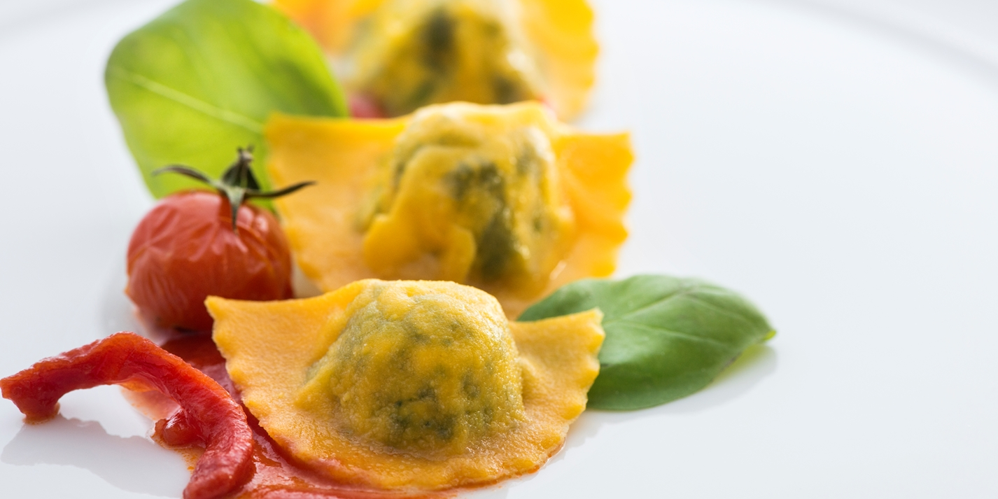 Ravioli with sheep's milk ricotta, spinach, tomato sauce and basil