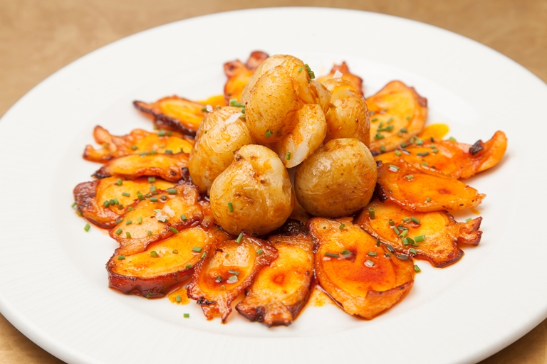 Octopus with baby potatoes, pimentón and olive oil