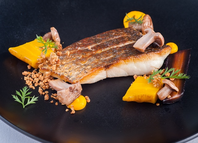 Seared sea bass with salt-baked heritage carrots