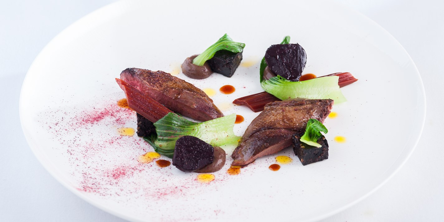 Roast wood pigeon with black pudding and baby beets