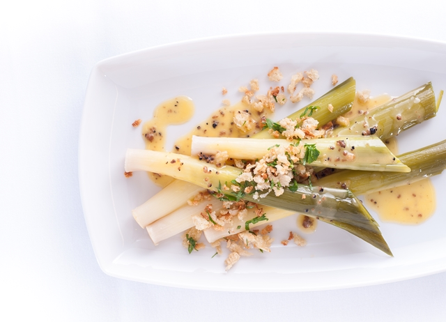 Baby leeks with truffle butter sauce and a garlic and herb crumb