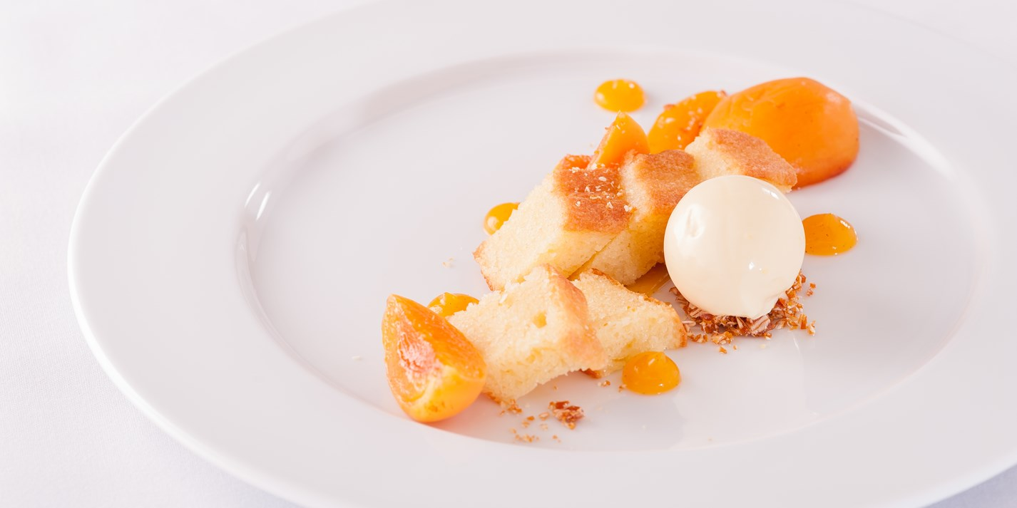 Poached apricots with almond sponge, apricot gel and clotted cream ice cream