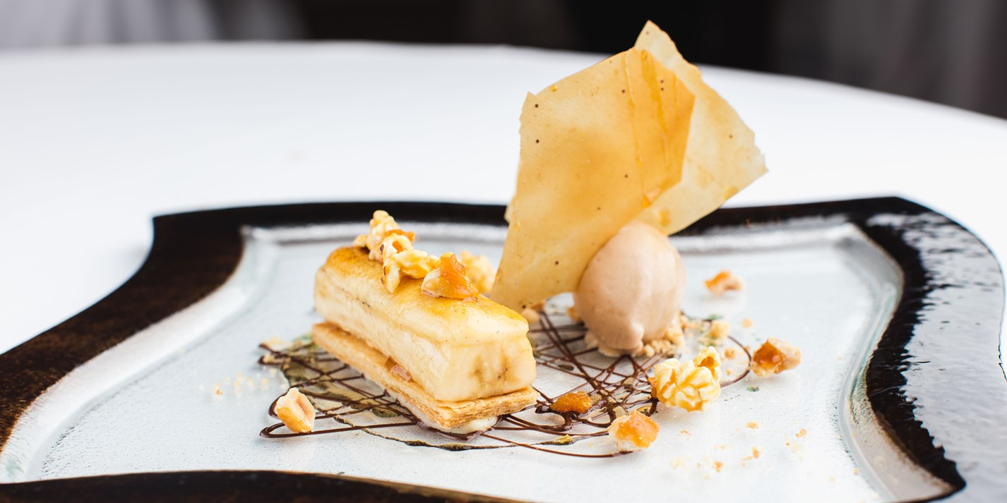 Caramelised banana mille-feuille with praline ice cream and toffee popcorn
