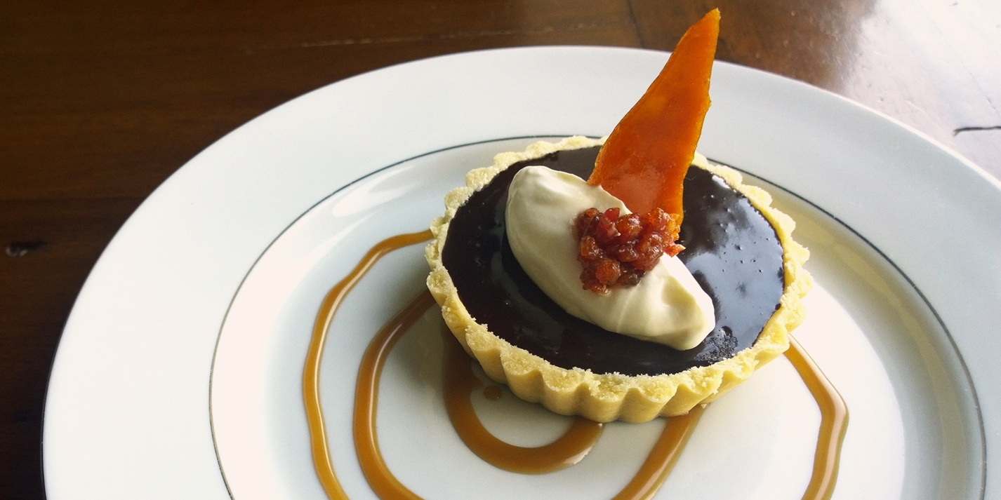 Candied bacon and chocolate tartlet with pork scratching snap