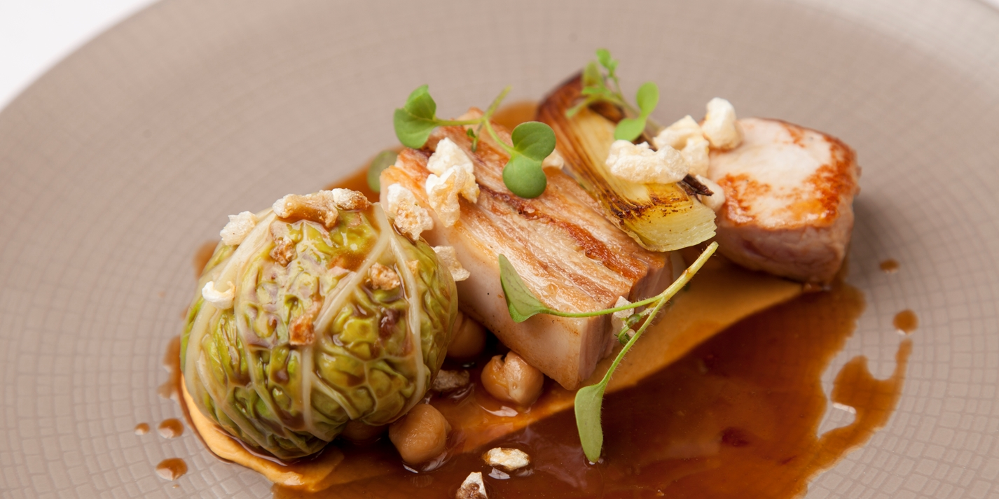 Pork with hummus, chou farci and chickpeas