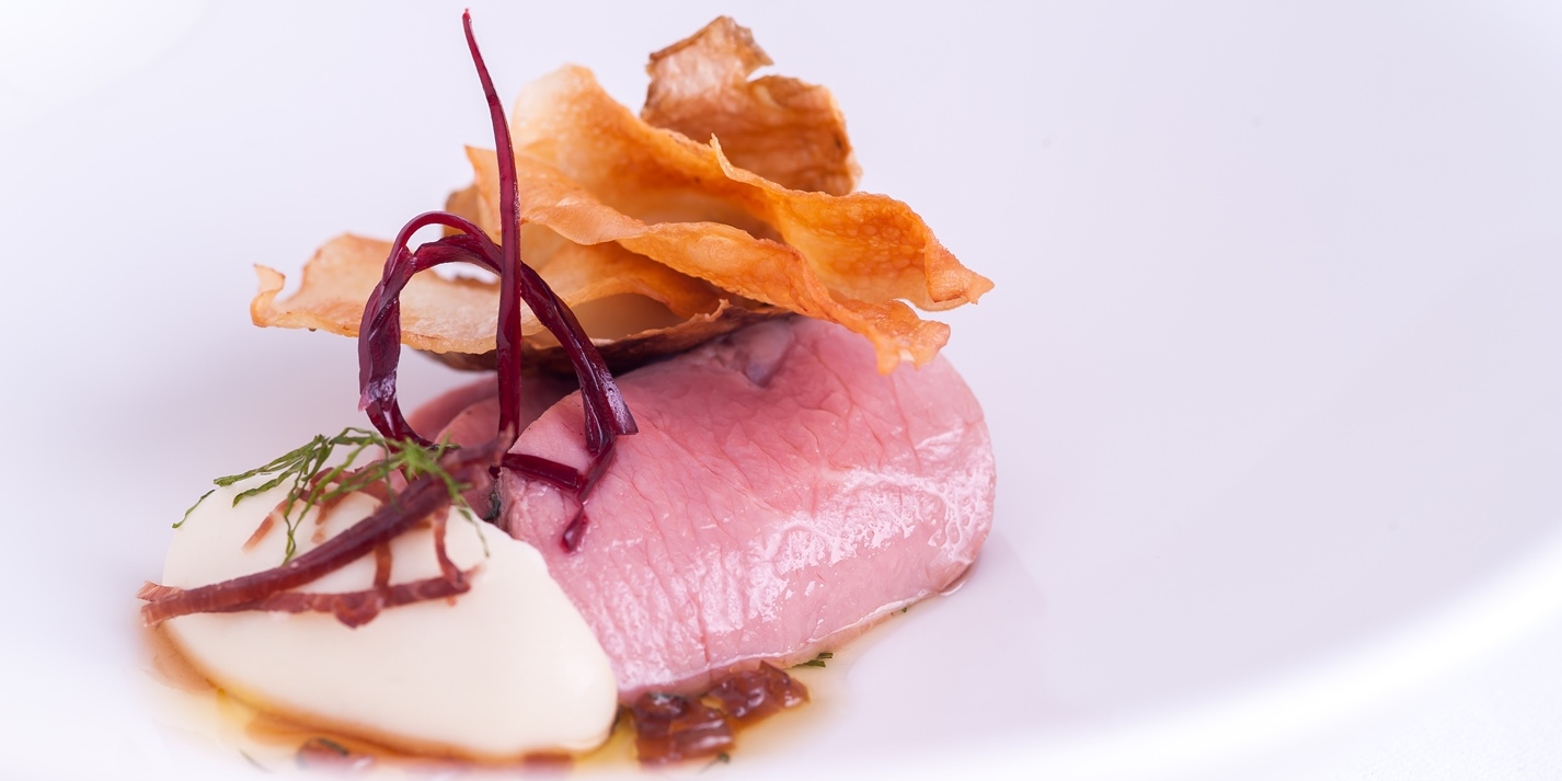 Loin of herdwick mutton with a honey and mint dressing and artichoke crisp