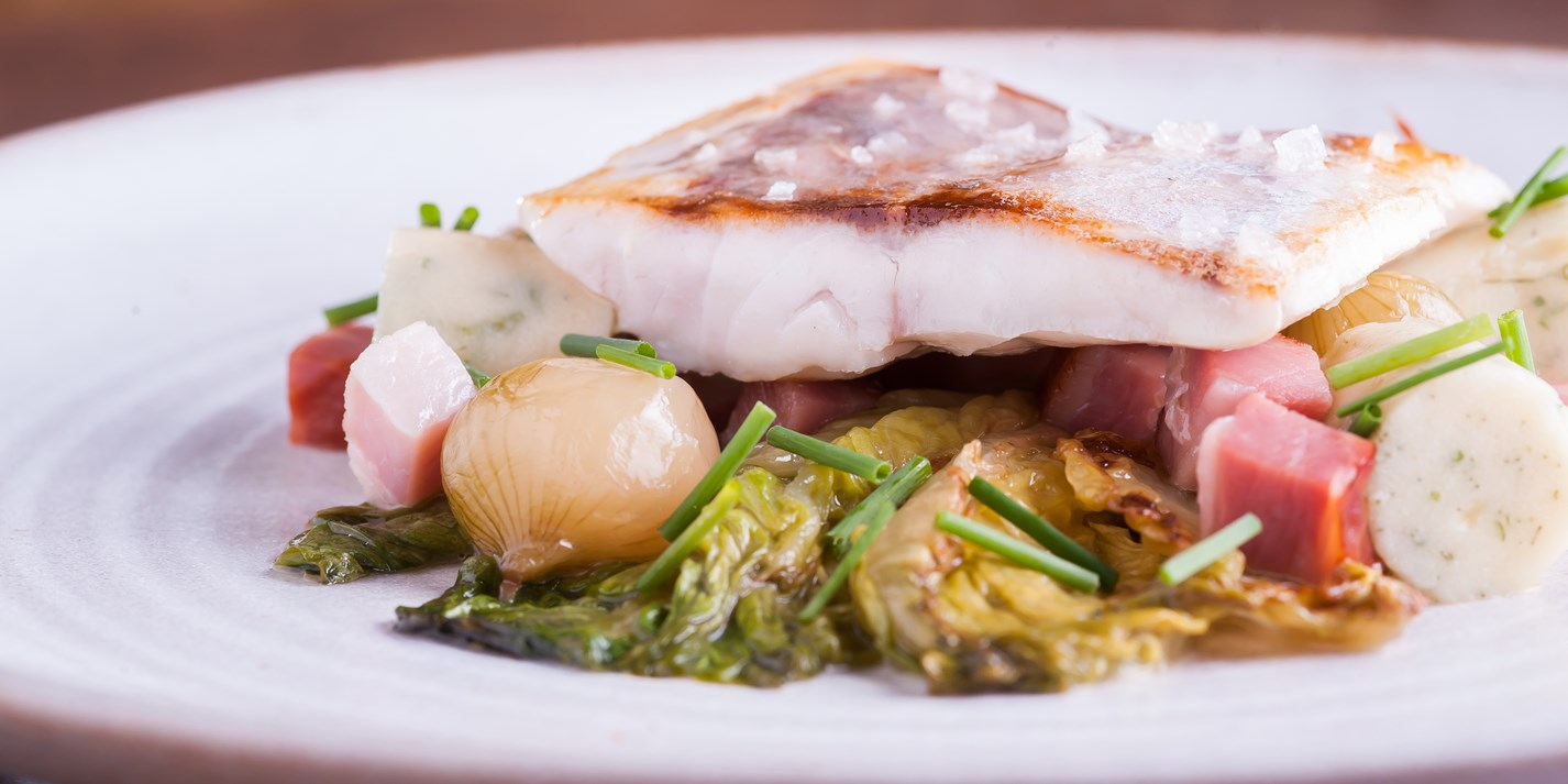 Sea bass with herb gnocchi, confit onions and horseradish sauce