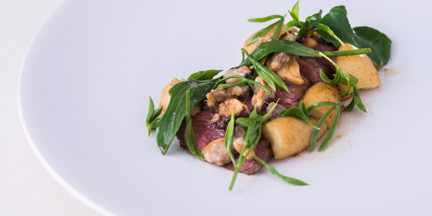 Hanger steak, clams, smoked garlic, sea vegetables