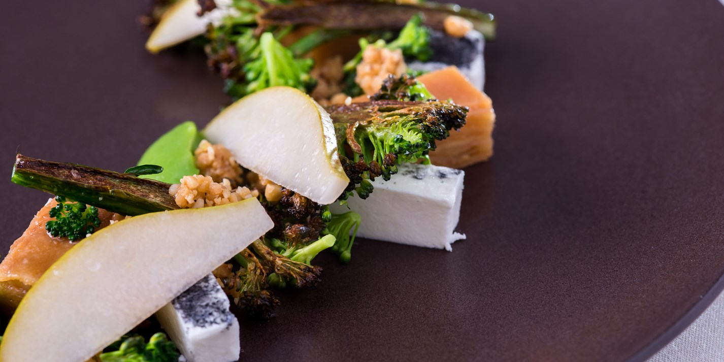 Charred tenderstem broccoli, Cerney Ash goat's cheese, quince terrine, hazelnuts