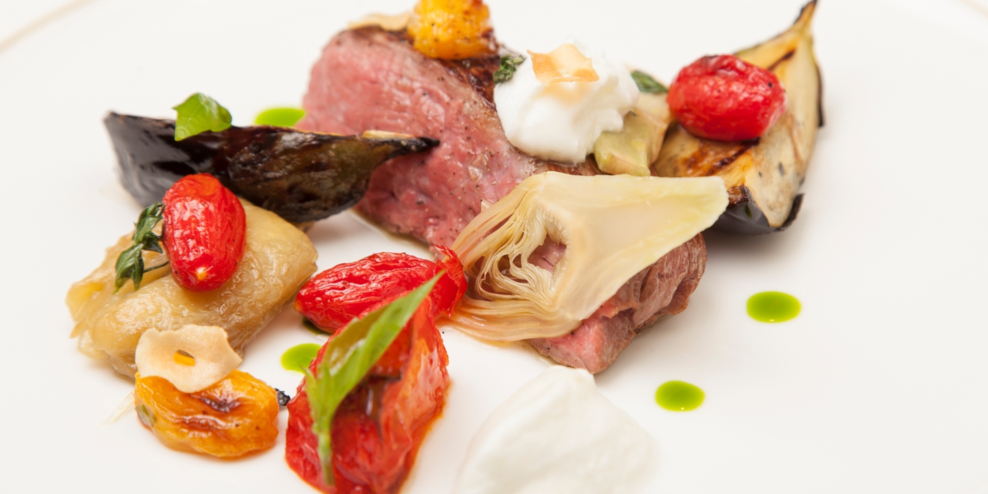 Lamb leg with sheep curd, aubergine caviar, artichoke and roasted tomatoes