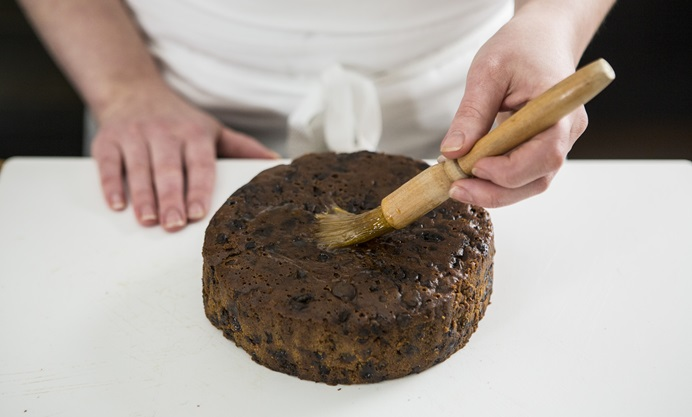 Place the cake on a cake board and, using a pastry brush, brush with apricot jam