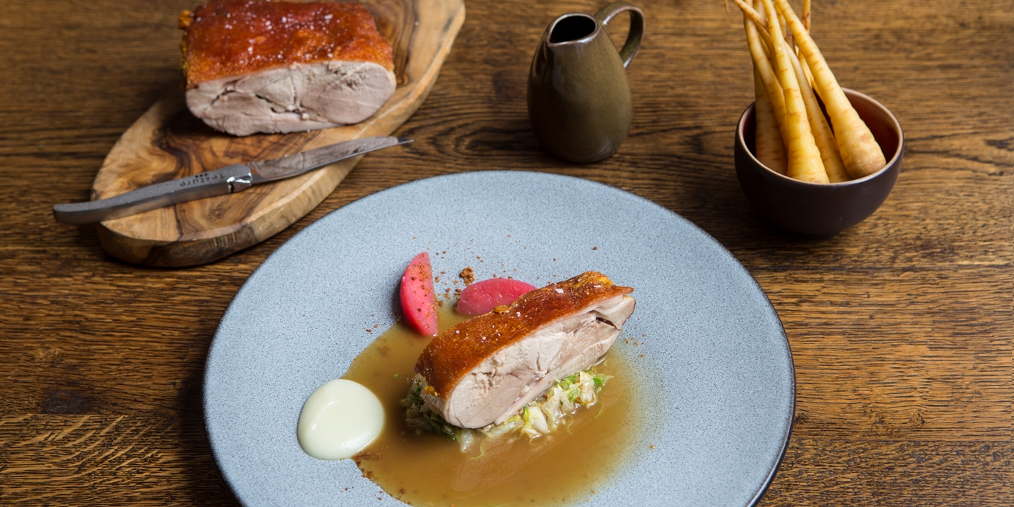 Pork shoulder with hispi cabbage and apples