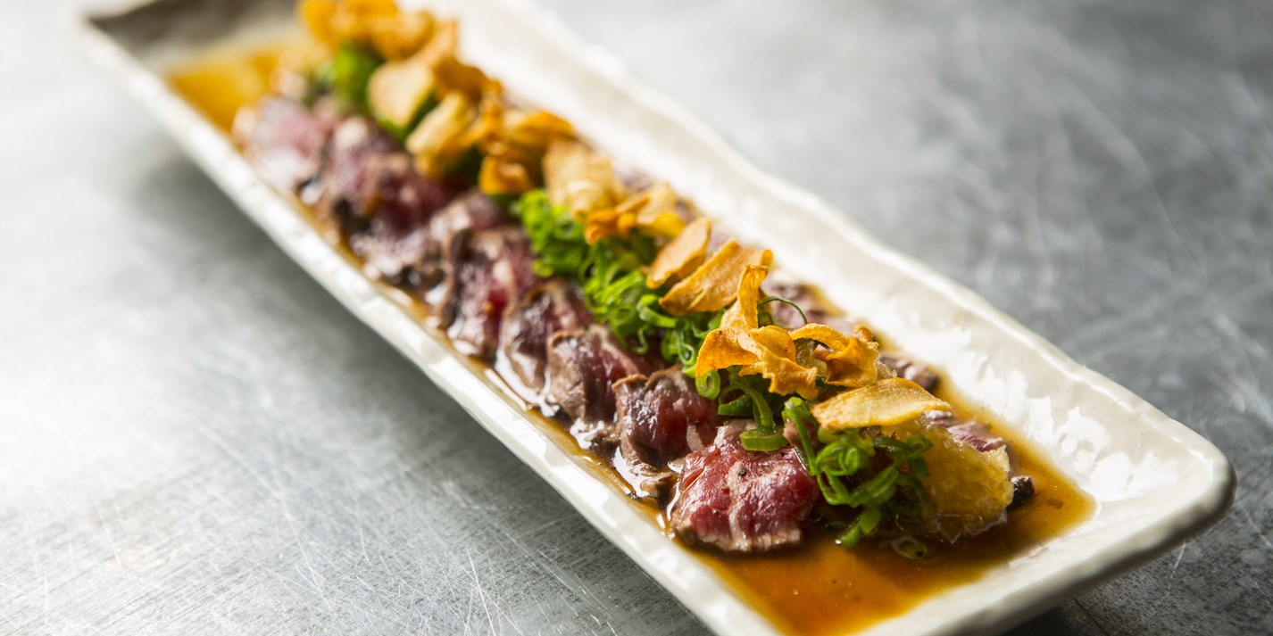Beef fillet tataki with onion ponzu and garlic crisps