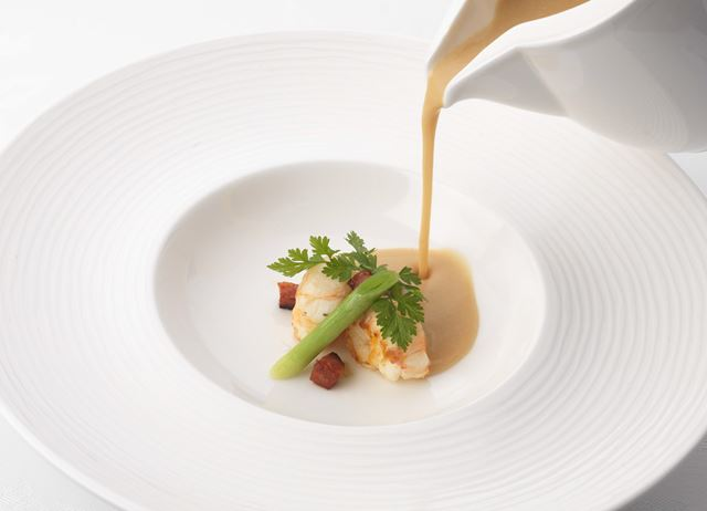 White bean velouté with chorizo and langoustine