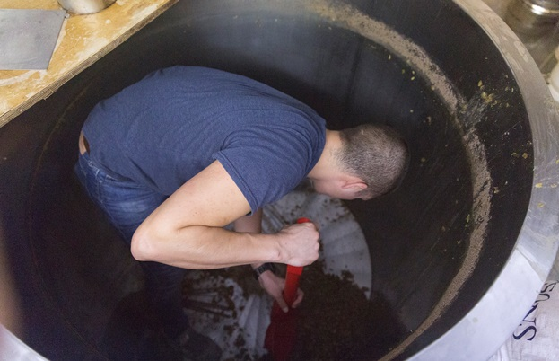 Hard graft – Julio cleaning the tanks at the brewery