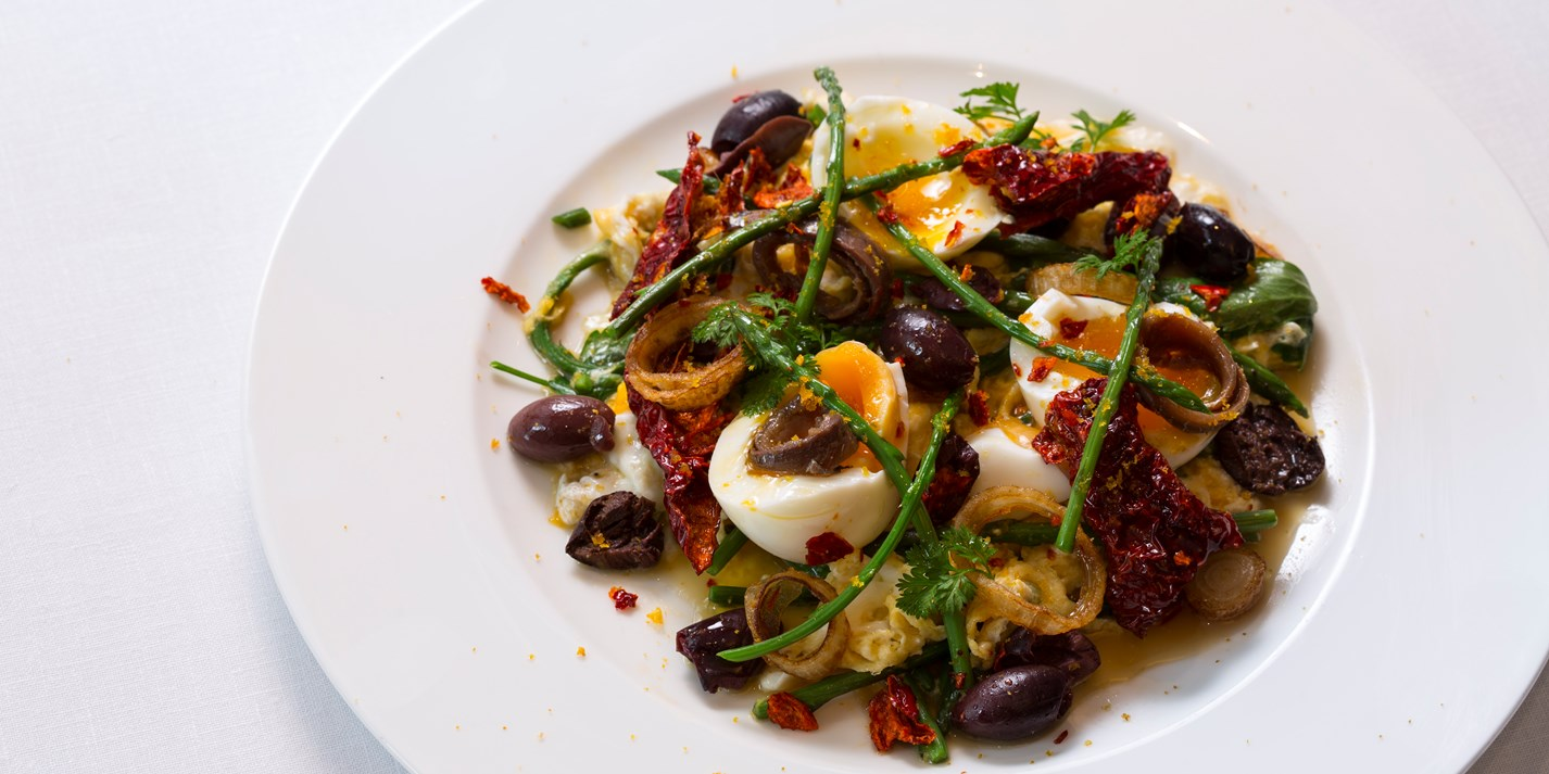 Warm egg salad with wild asparagus, olive and chilli
