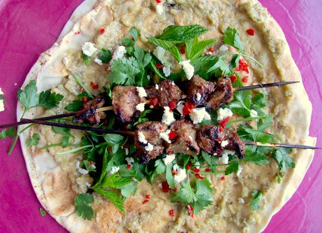 Barbecued lamb, smoky aubergine and feta wraps