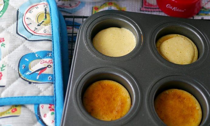 Pour a scant spoonful of mixture into each cake hole and evenly spread.
