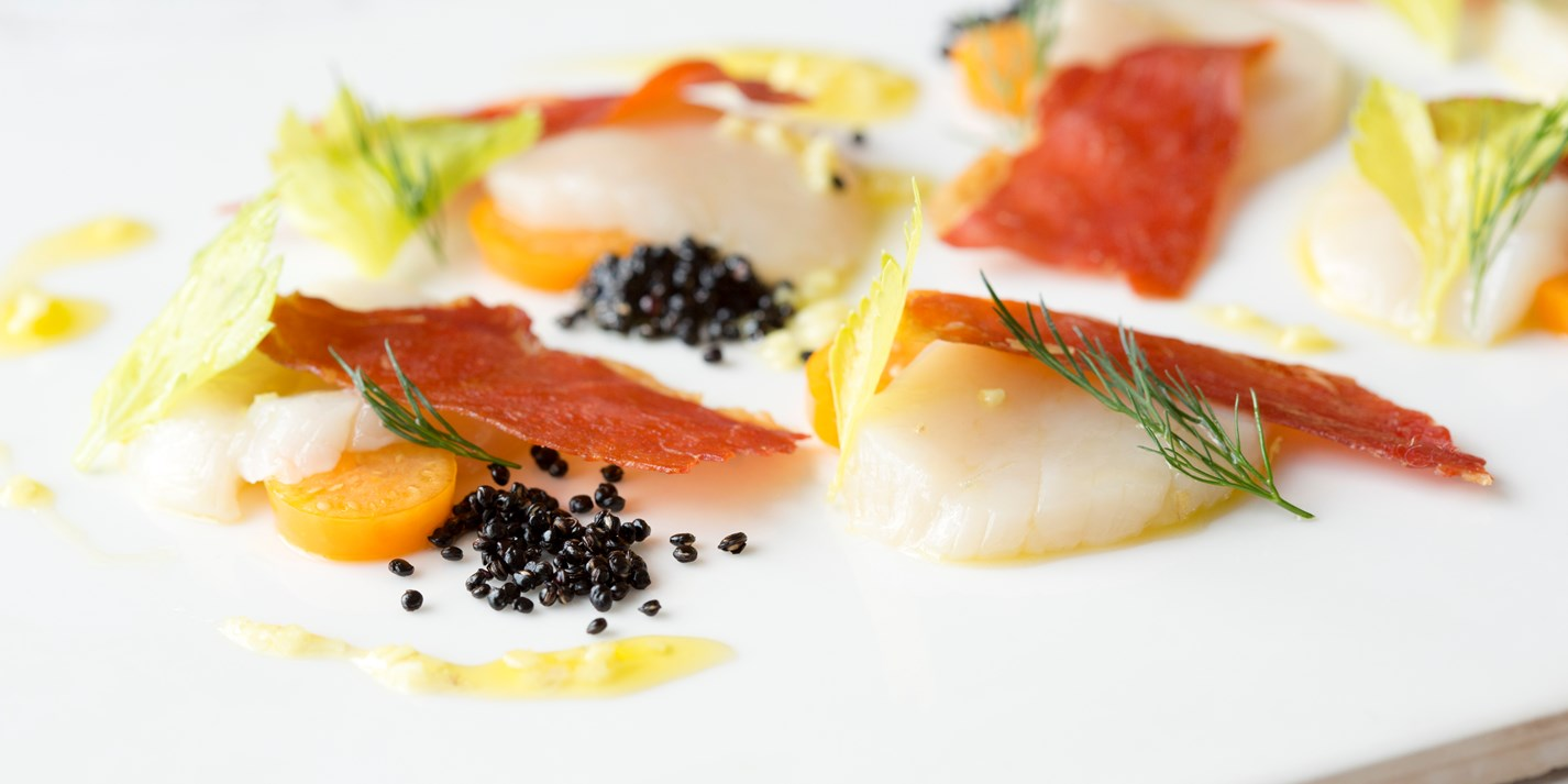 Yuzu marinated scallops with kumquats and prosciutto