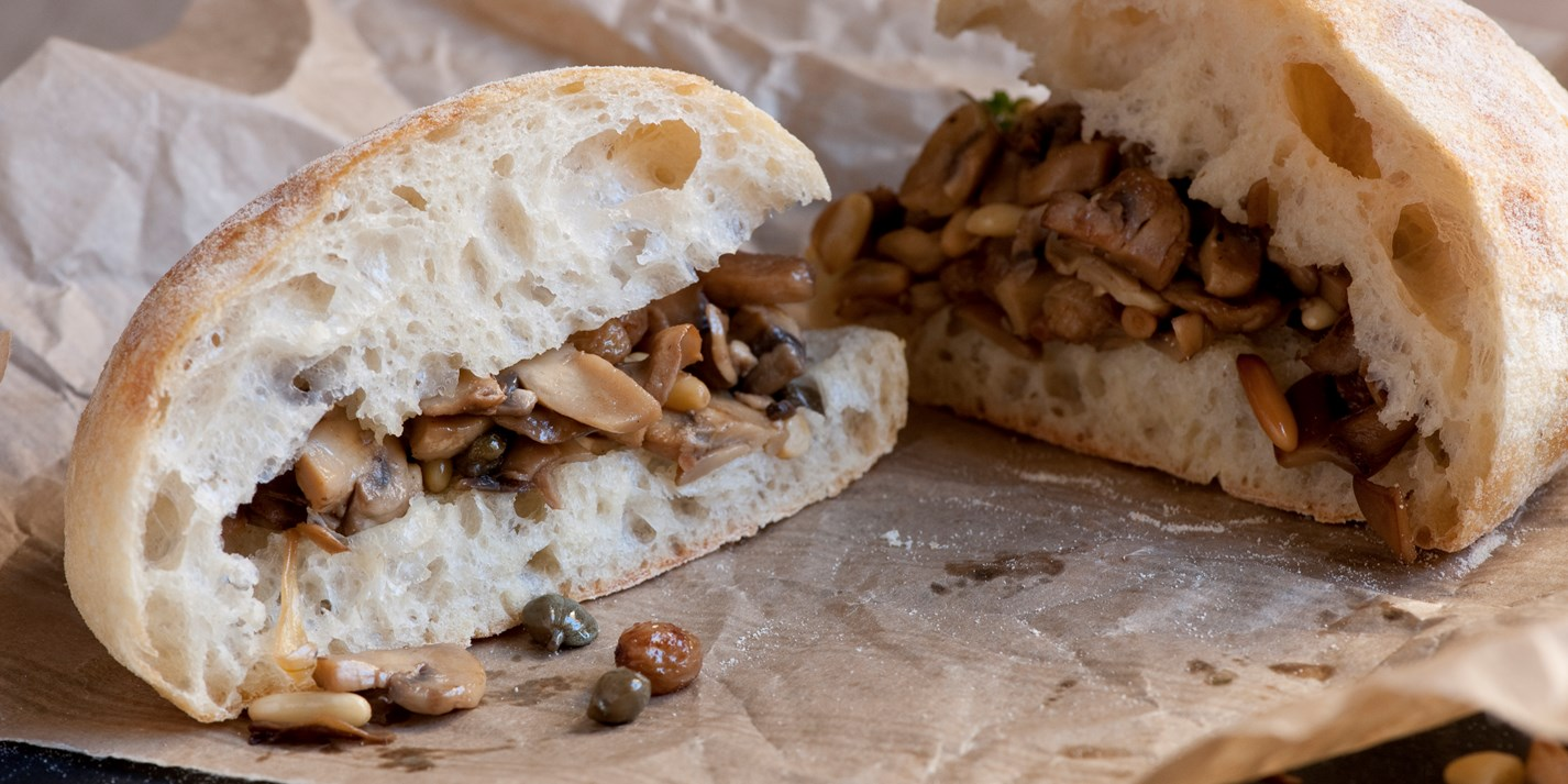 Mushroom sandwich with pine nuts, raisins and capers