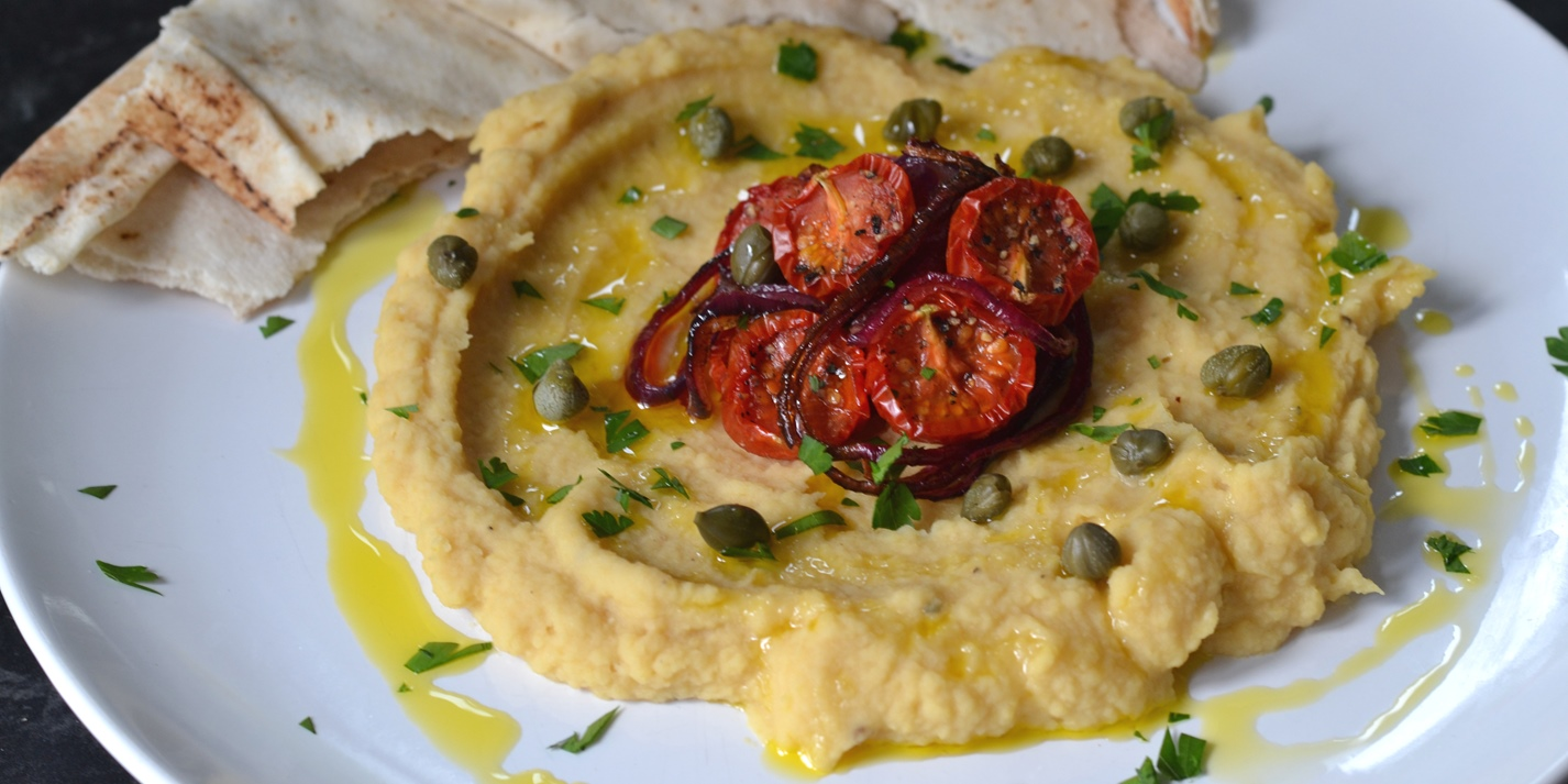 Yellow split pea purée with slow roast Piccolo tomatoes, caramelised onion and capers