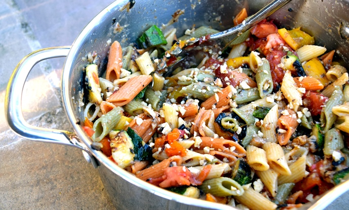 Mezze penne tricolour with roasted summer vegetables and walnuts