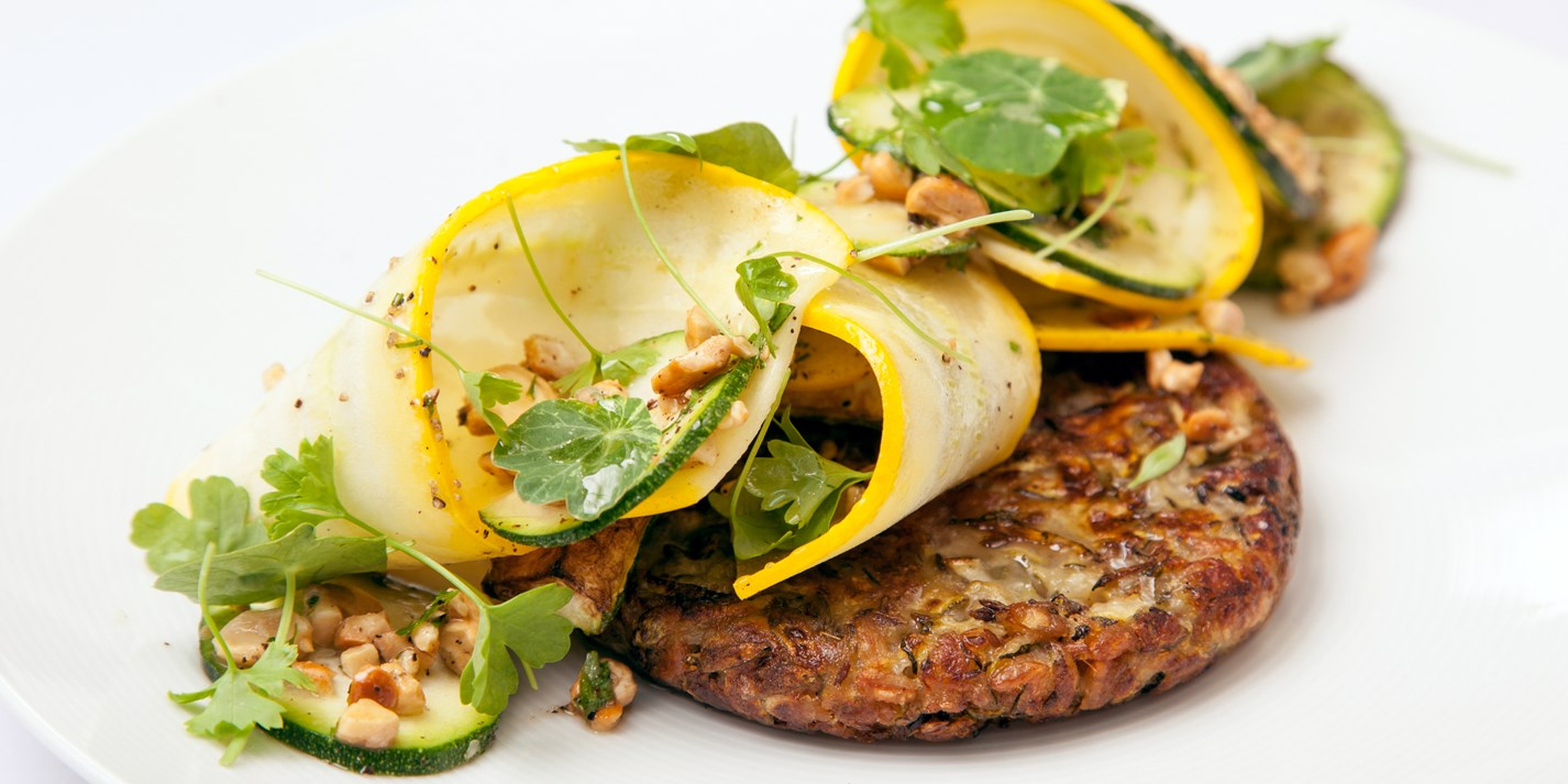 Courgette, spelt and cumin fritters, courgette, parsley and cashew salad