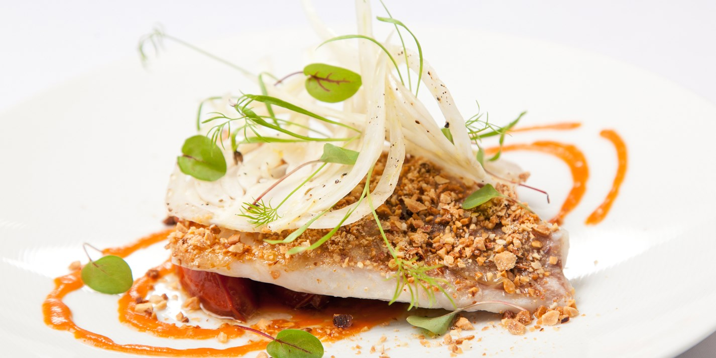 Slow-cooked crusted sea bream, Andalusian tomato, smoked almonds, fennel, lemon