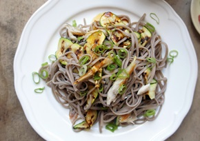 Soba salad with hot smoked mackerel, spring onions, courgettes