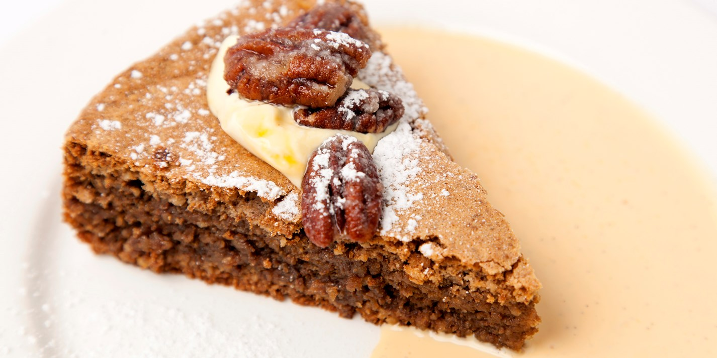 Walnut cake, pecans and cream